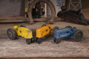 Three Hubley Toy Tractors